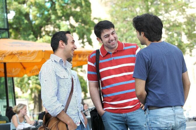 Three students talking to each other